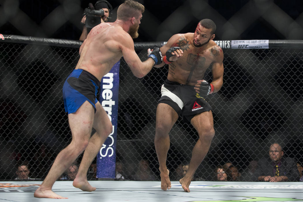 Gerald Meerschaert, left, battles Thiago Santos in the UFC 213 middleweight bout at T-Mobile Arena in Las Vegas, Saturday, July 8, 2017. Santos won by technical knockout. Erik Verduzco Las Vegas R ...