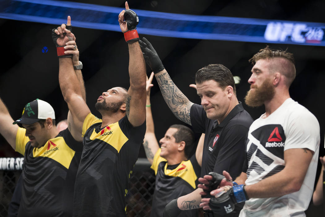 Thiago Santos, left, is announced the winner against Gerald Meerschaert in the UFC 213 middleweight bout at T-Mobile Arena in Las Vegas, Saturday, July 8, 2017. Santos won by technical knockout. E ...
