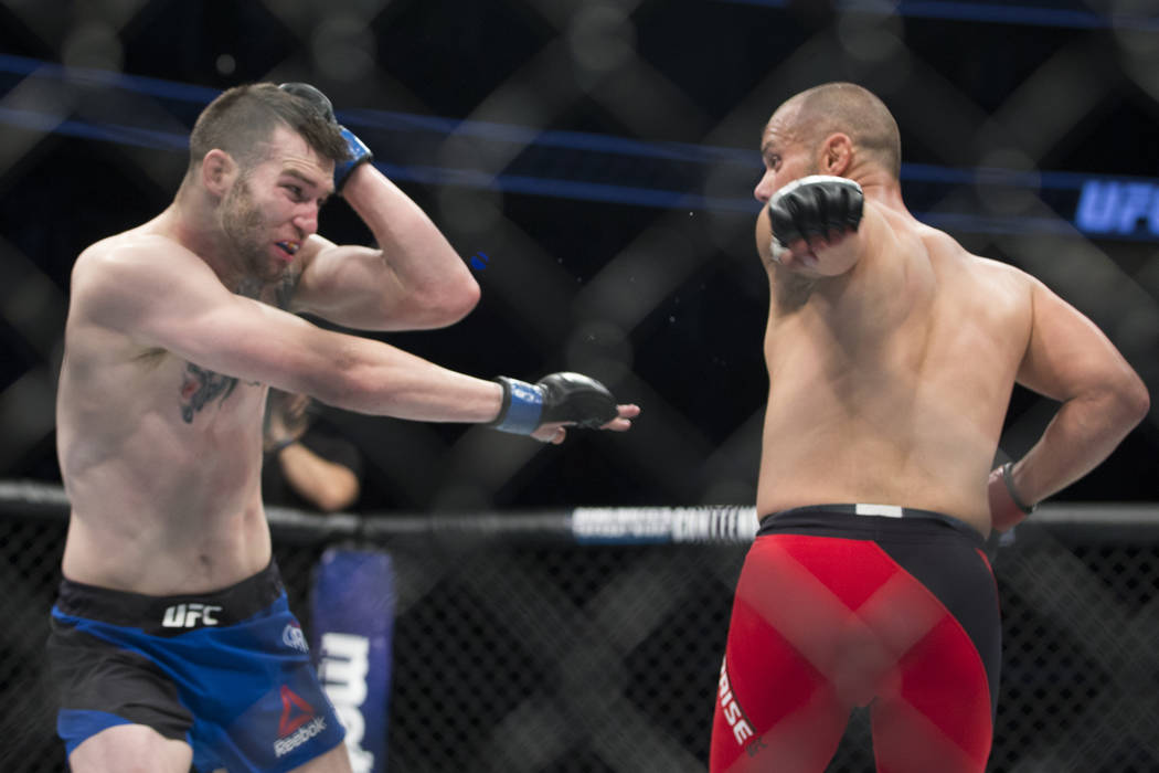 Brian Camozzi, left, battles Chad Laprise in the UFC 213 welterweight bout at T-Mobile Arena in Las Vegas, Saturday, July 8, 2017. Laprise won by technical knockout. Erik Verduzco Las Vegas Review ...