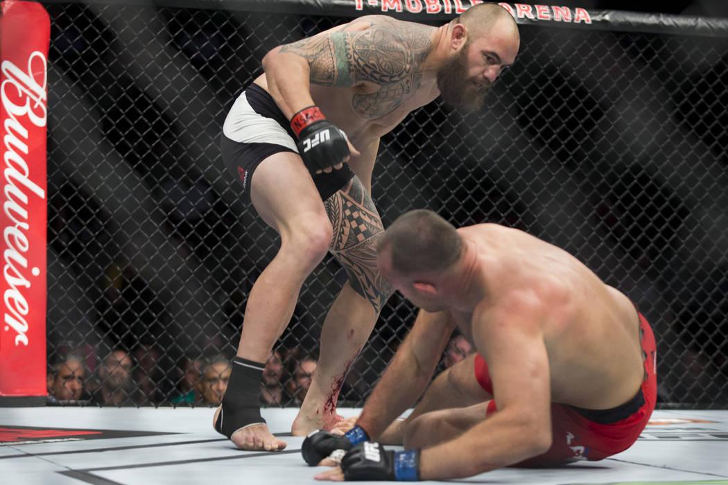 Travis Browne battles Aleksei Oleinik in the UFC 213 heavyweight bout at T-Mobile Arena in Las Vegas, Saturday, July 8, 2017. Oleinik won by way of submission. Erik Verduzco Las Vegas Review-Journ ...
