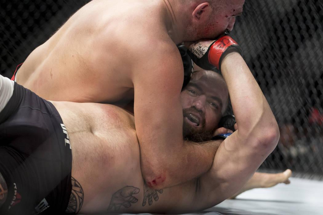Aleksei Oleinik, top, battles Travis Browne in the UFC 213 heavyweight bout at T-Mobile Arena in Las Vegas, Saturday, July 8, 2017. Oleinik won by way of submission. Erik Verduzco Las Vegas Review ...