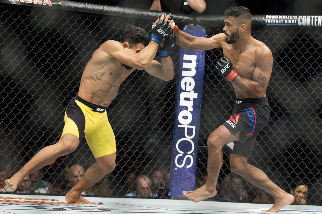Douglas Silva de Andrade, left, battles Rob Font in the UFC 213 bantamweight bout in the UFC 213 bantamweight bout at T-Mobile Arena in Las Vegas, Saturday, July 8, 2017. Font won by way of submis ...