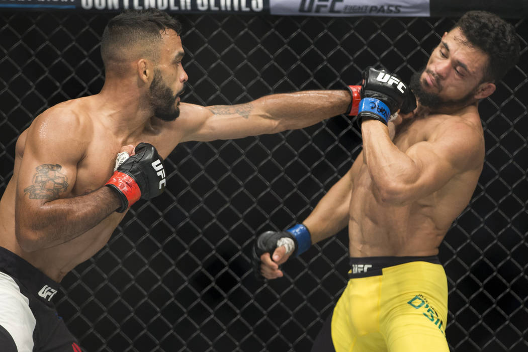 Rob Font, left, battles Douglas Silva de Andrade in the UFC 213 bantamweight bout at T-Mobile Arena in Las Vegas, Saturday, July 8, 2017. Font won by way of submission. Erik Verduzco Las Vegas Rev ...