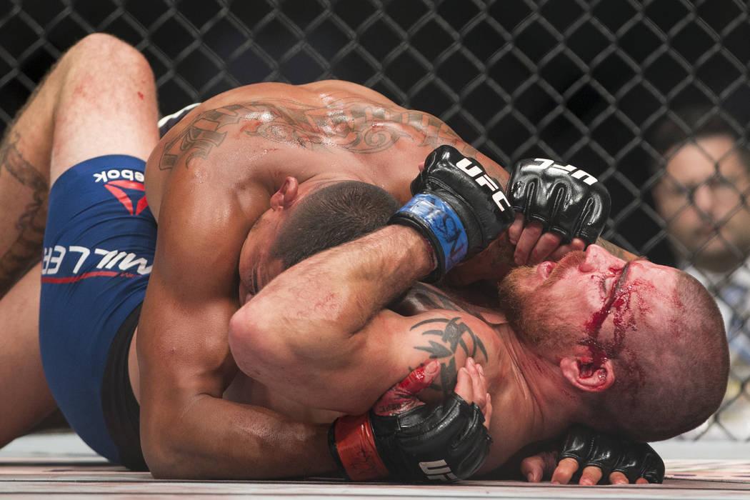 Anthony Pettis, top, battles Jim Miller in the UFC 213 lightweight bout at T-Mobile Arena in Las Vegas, Saturday, July 8, 2017. Pettis won by unanimous decision. Erik Verduzco Las Vegas Review-Jou ...