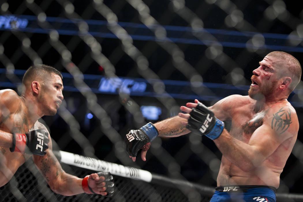 Anthony Pettis, left, battles Jim Miller in the UFC 213 lightweight bout at T-Mobile Arena in Las Vegas, Saturday, July 8, 2017. Pettis won by unanimous decision. Erik Verduzco Las Vegas Review-Jo ...