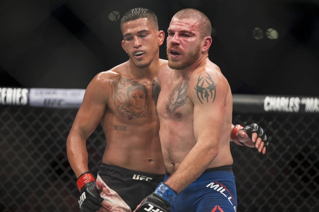 Anthony Pettis, left, embraces Jim Miller at the end of their fight in the UFC 213 lightweight bout at T-Mobile Arena in Las Vegas, Saturday, July 8, 2017. Pettis won by unanimous decision. Erik V ...