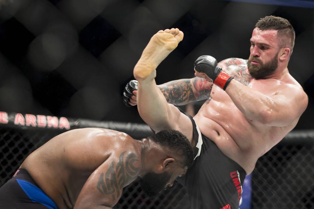 Curtis Blaydes, left, battles Daniel Omielanczuk in the UFC 213 heavyweight bout at T-Mobile Arena in Las Vegas, Saturday, July 8, 2017. Blaydes won by unanimous decision. Erik Verduzco Las Vegas  ...