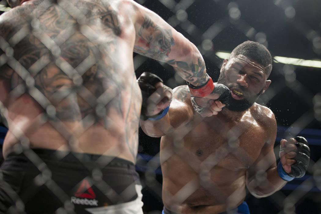 Daniel Omielanczuk, left, battles Curtis Blaydes in the UFC 213 heavyweight bout at T-Mobile Arena in Las Vegas, Saturday, July 8, 2017. Blaydes won by unanimous decision. Erik Verduzco Las Vegas  ...