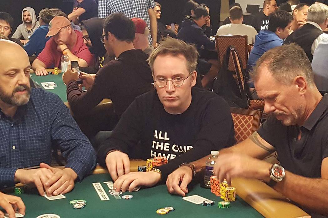 England's Sam Grafton, center, held the lead for most of the action Saturday and is in second place after Day 1A of the World Series of Poker's $10,000 buy-in No-limit Texas Hold 'em World Cha ...