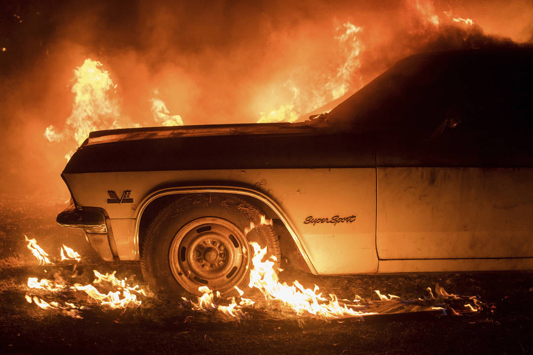 Flames from a wildfire consume a car near Oroville, Calif., on Saturday, July 8, 2017. Evening winds drove the fire through several neighborhoods leveling homes in its path. (Noah Berger/AP)