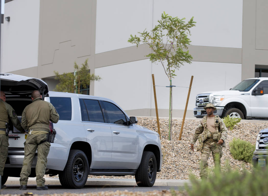 Police respond to reports of a gunman at the Davis Funeral Home down the street off of Harrison Drive and Patrick Lane about 10 a.m. Sunday, July 9, 2017 in Las Vegas. Elizabeth Brumley Las Vegas  ...