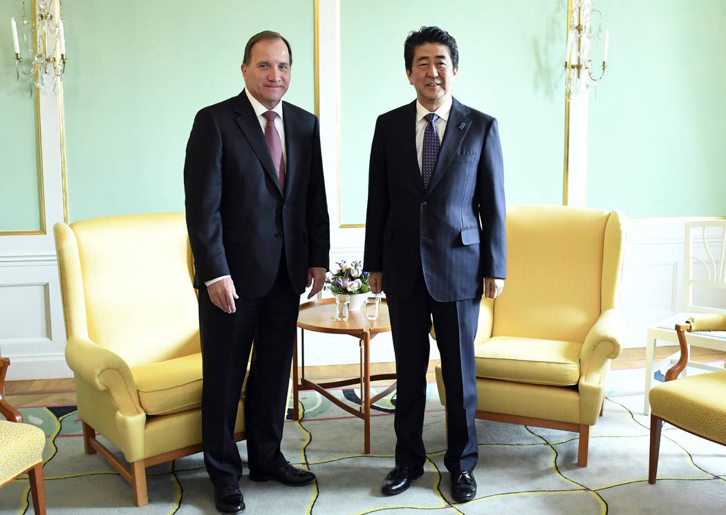 Swedish prime minister Stefan Lofven, left, and Japanese Prime Minister Shinzo Abe pose for a photo before their meeting in Stockholm, Sunday, July 9, 2017. Shinzo Abe is in Stockholm for a two da ...