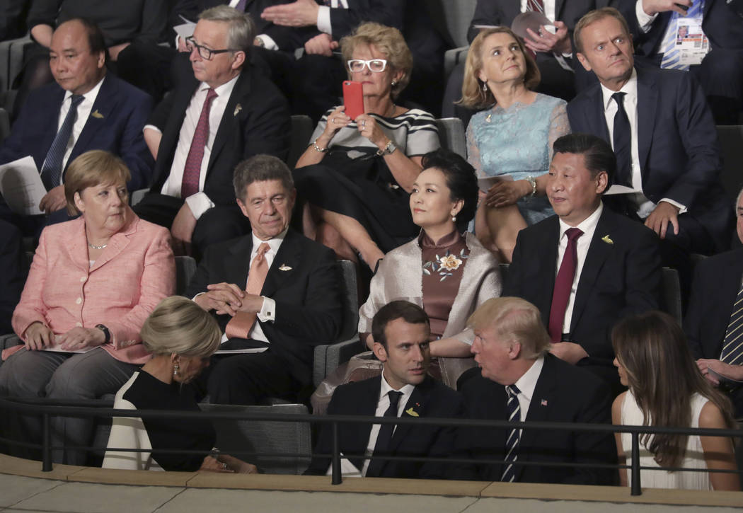 Leaders, including German Chancellor Angela Merkel, left, and their partners attend a concert at the Elbphilharmonie concert hall on the first day of the G-20 summit in Hamburg, northern Germany,  ...