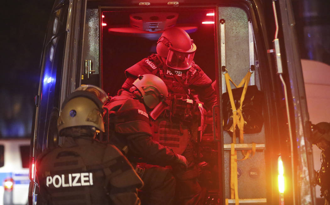 Heavily armed special police forces arrive at the so-called 'Schanzenviertel' area after riots started on the sidelines of the G-20 summit in Hamburg, northern Germany, Friday evening, July 7, 201 ...