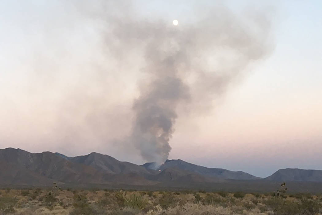 A wildfire burns on the Pahrump side of Potosi Mountain (Larry Haydu/Clark County)