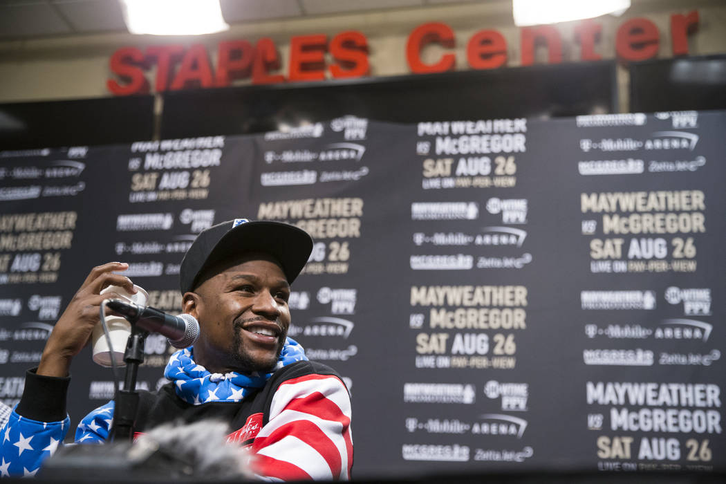 Boxer Floyd Mayweather Jr., during a world tour event stop to promote his upcoming fight against UFC fighter Conor McGregor, at Staples Center in Los Angeles, Calif., on Tuesday, July 11, 2017. Er ...