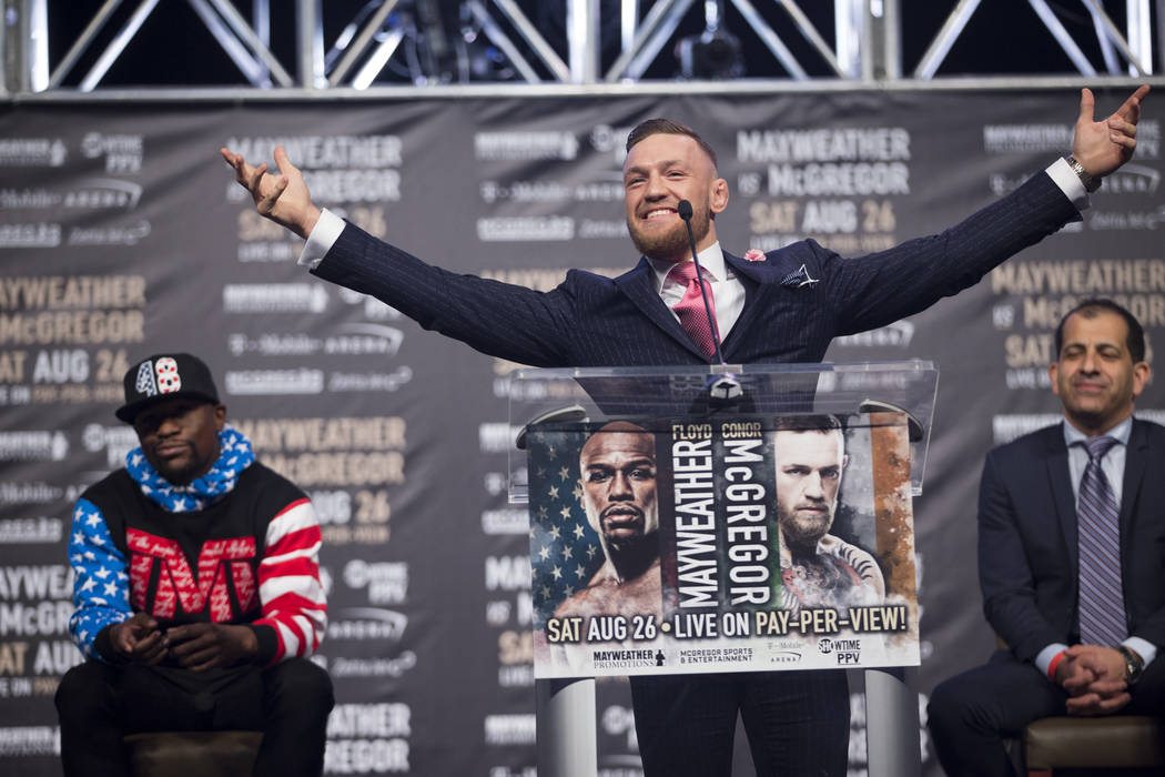 UFC fighter Conor McGregor, center, during a press conference in a world boxing tour to promote his upcoming fight against Floyd Mayweather Jr., at Staples Center in Los Angeles, Calif., on Tuesda ...