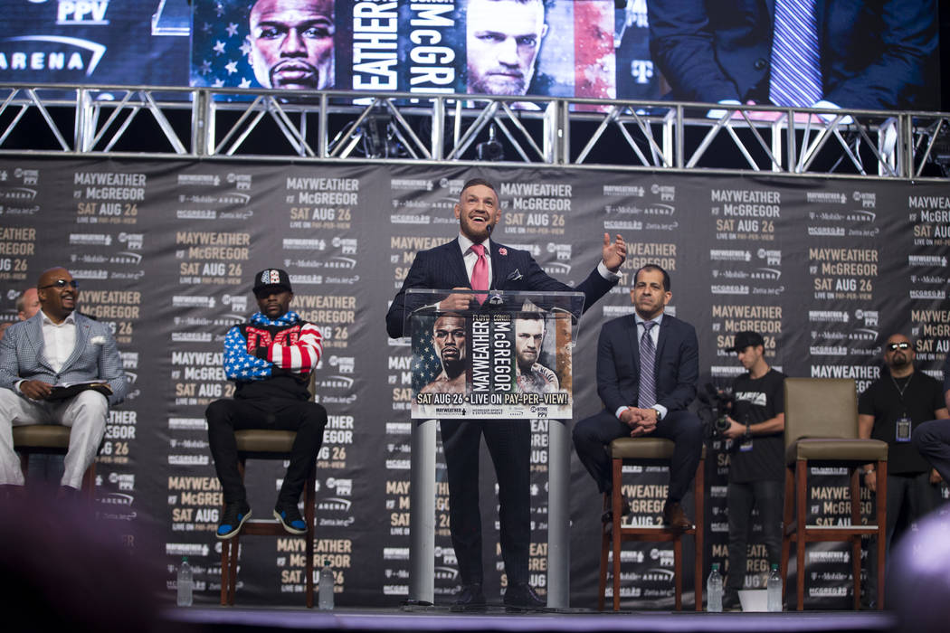 UFC fighter Conor McGregor, center, during a world tour event stop to promote his upcoming fight against Boxer Floyd Mayweather Jr., at Staples Center in Los Angeles, Calif., on Tuesday, July 11,  ...