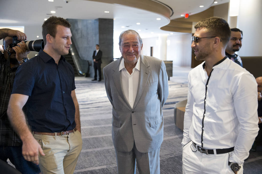 Boxers Jeff Horn, left, and Vasyl Lomachenko, right, meet as promoter Bob Arum look on during a press conference in Los Angeles, Calif., on Wednesday, July 12, 2017. Erik Verduzco Las Vegas Review ...