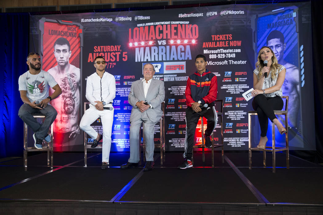 Boxers Raymundo Beltran, from left, Vasyl Lomachenko, Miguel Marriaga, fourth from left, promoter Bob Arum, third from left, and reporter Crystina Poncher during a press conference in Los Angeles, ...