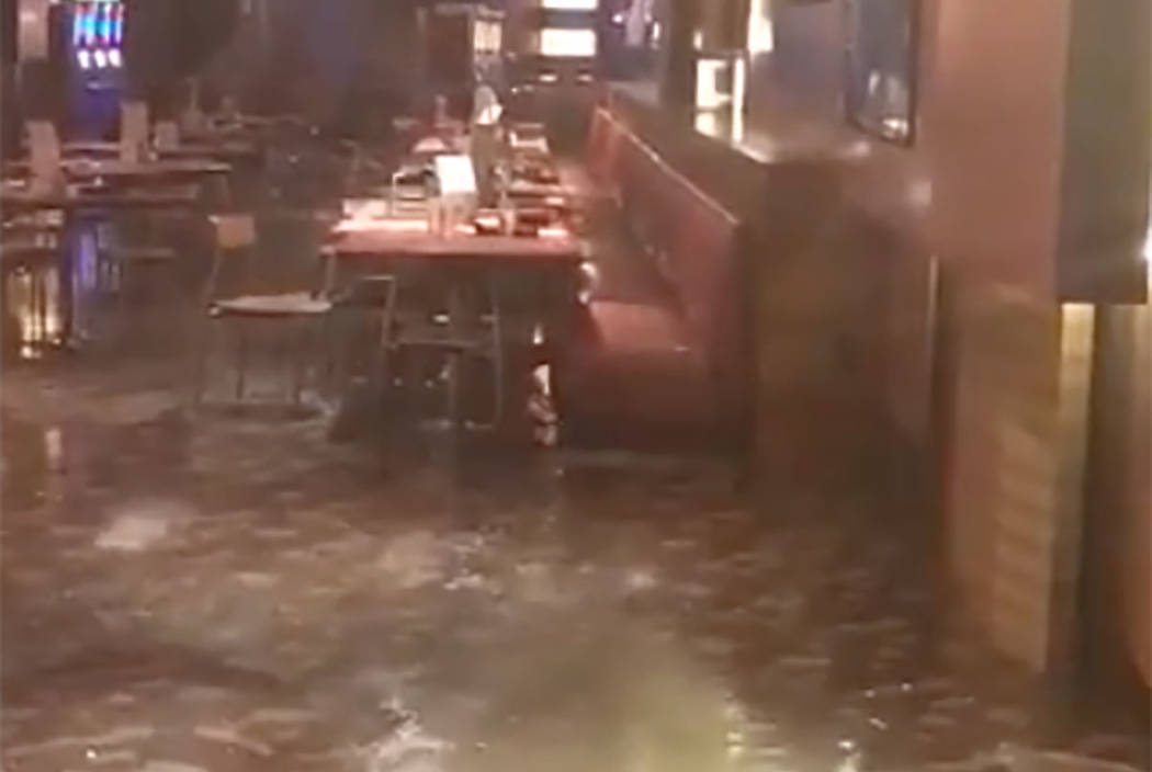 Flooding is seen at a bar/restaurant area inside Planet Hollywood Resort on Saturday. (screengrab from Facebook video)