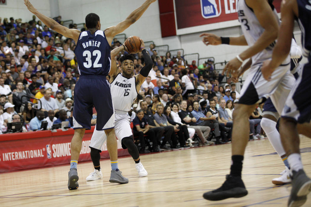 Sacramento Kings Frank Mason (15) attempts to pass a ball past the Memphis Grizzlies Vince Hunter (32) during the NBA Summer League on Sunday, July 9, 2017, at the Thomas & Mack Center in Las  ...