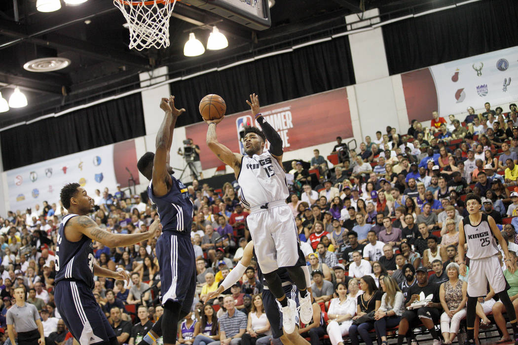 Sacramento Kings Frank Mason (15) attempts to pass a ball past the Memphis Grizzlies Amir Williams (35), from left, and Wes Washpun (12) during the NBA Summer League on Sunday, July 9, 2017, at th ...