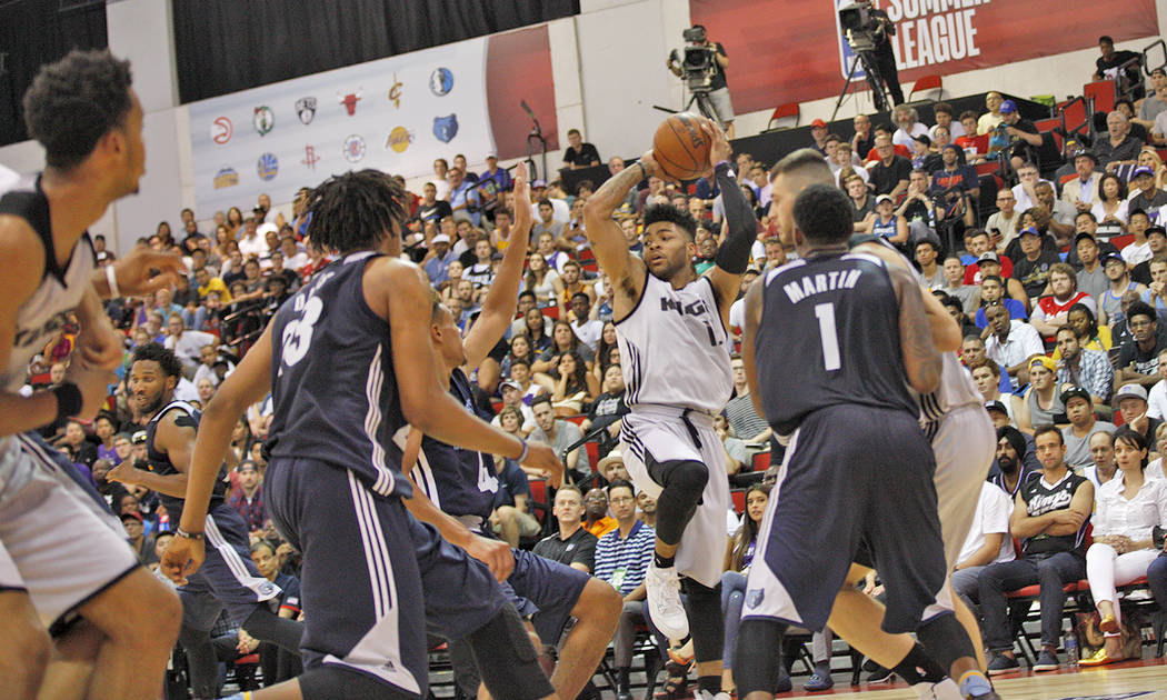 Sacramento Kings Frank Mason (15) attempts to pass a ball past the Memphis Grizzlies Wade Baldwin IV (4) during the NBA Summer League on Sunday, July 9, 2017, at the Thomas & Mack Center in La ...