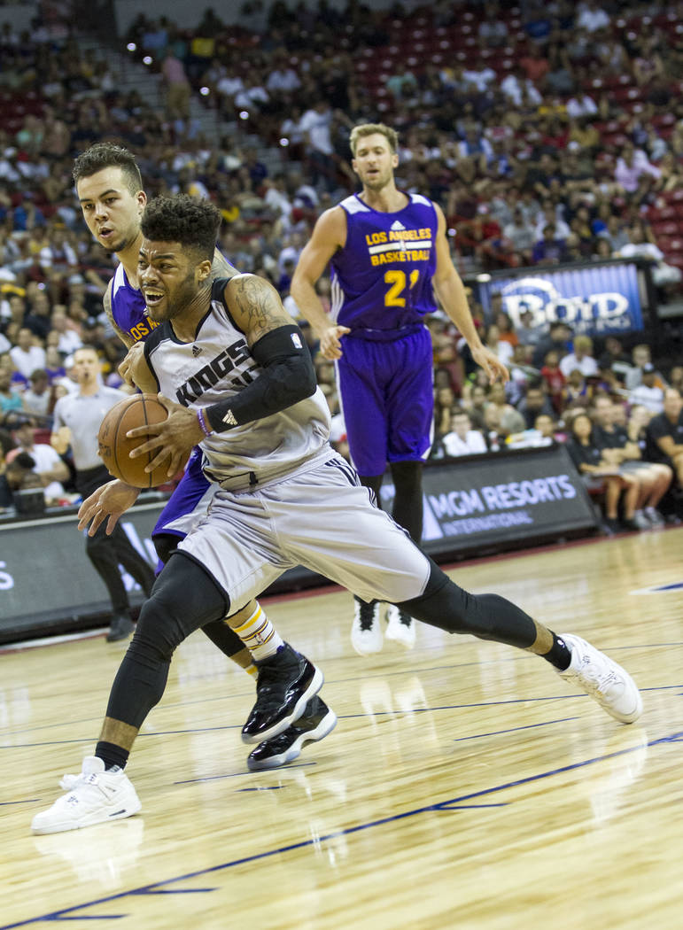 Sacramento Kings point guard Frank Mason III (15) is pressured by Los Angeles Lakers defenders during the NBA summer league at the Thomas & Mack Center, Monday, July 10, 2017. Richard Brian La ...