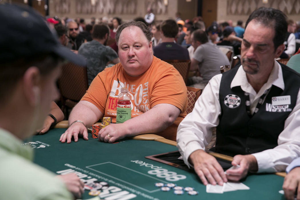Greg Raymer, left, studies his table's game during the World Series of Poker at the Rio Convention Center in Las Vegas, Tuesday,July 11, 2017.  Gabriella Angotti-Jones Las Vegas Review-Journal @ga ...