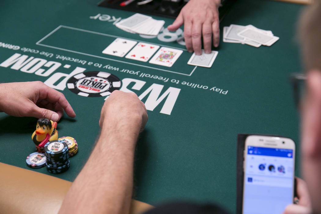 A rock 'n' roll rubber duck sits next to poker chips during the World Series of Poker at the Rio Convention Center in Las Vegas, Tuesday,July 11, 2017.  Gabriella Angotti-Jones Las Vegas Review-Jo ...
