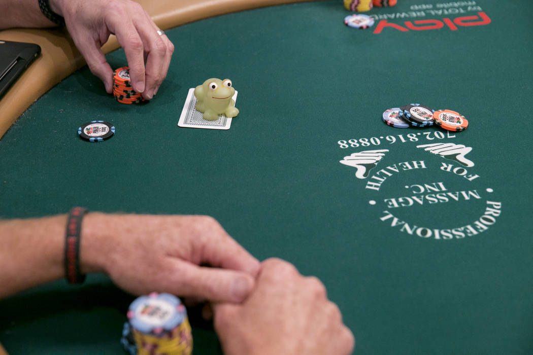 Warren Maxwell's rubber frog sits on top of a playing card during the World Series of Poker at the Rio Convention Center in Las Vegas, Tuesday,July 11, 2017.  Gabriella Angotti-Jones Las Vegas Rev ...