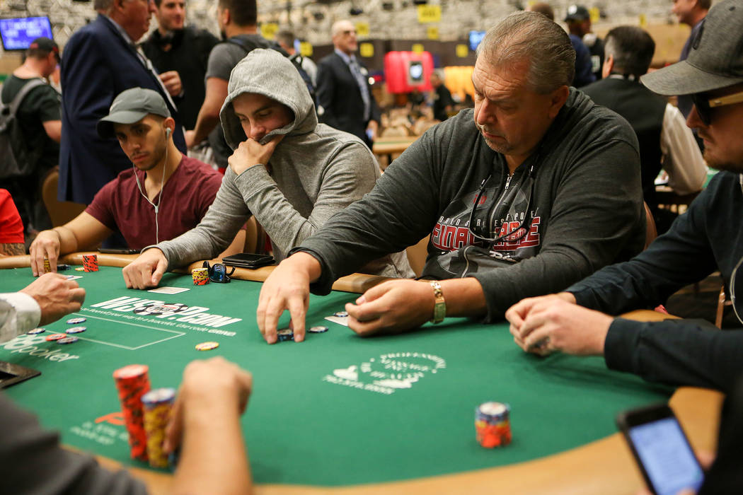 Dieter Dechant, second from right, collects his chips during the World Series of Poker at Rio Convention Center on Wednesday, July 12, 2017, in Las Vegas. Bridget Bennett/Las Vegas Review-Journal  ...