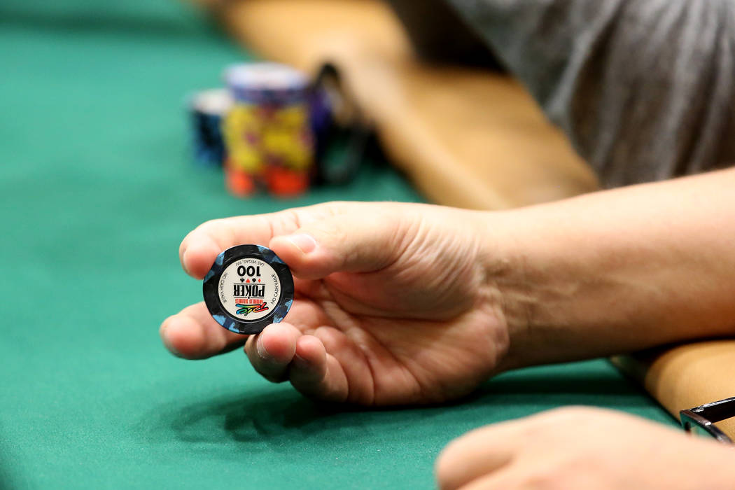 """Dieter Dechant holds a chip during the World Series of Poker at Rio Convention Center on Wednesday, July 12, 2017, in Las Vegas. Dechant won the WSOP's """"The Giant"""" No-Limit Hold' ..."""