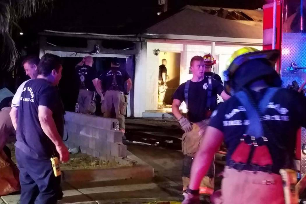 Crews with Las Vegas Fire Department put out an early Monday morning fire at 1726 Lewis Ave. (Mike Shoro/Las Vegas Review-Journal)