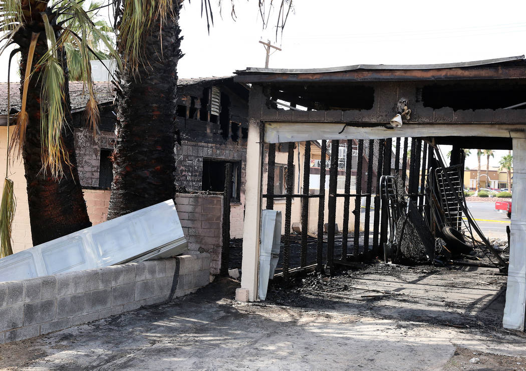 A fire damaged a house at 1726 Lewis Ave., left, Monday, July 10, 2017, in Las Vegas. The family escaped unharmed. (Bizuayehu Tesfaye/Las Vegas Review-Journal) @bizutesfaye