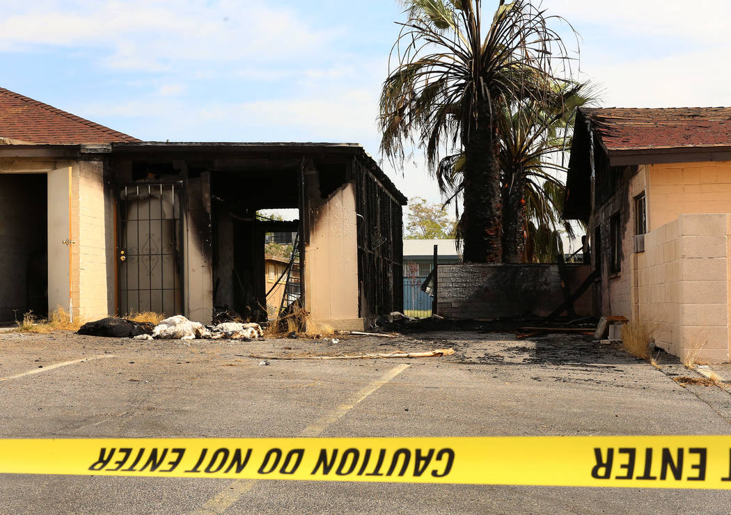 A fire damaged a house at 1726 Lewis Ave., left, Monday, July 10, 2017, in Las Vegas. The family escaped unharmed. The house at the right also sustained fire damage. (Bizuayehu Tesfaye/Las Vegas R ...