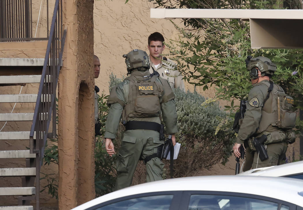 Las Vegas police and SWAT are at the scene of a barricade situation at an apartment complex at 2851 S. Decatur Blvd., just south of Sahara Avenue, Monday, July 10, 2017, in Las Vegas. Bizuayehu Te ...