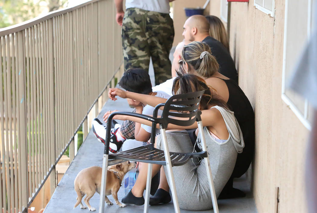 Residents watch as Las Vegas SWAT officers respond to a barricade situation at an apartment complex at 2851 S. Decatur Blvd., just south of Sahara Avenue, Monday, July 10, 2017, in Las Vegas. Bizu ...