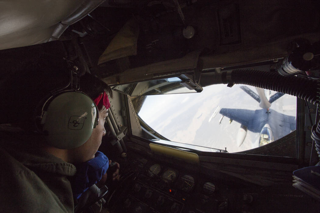 Senior Airman Eric Medina, of the 93rd refueling squadron, refuels an F-16C from the 79th Fighter Squadron over Southern Nevada during a Red Flag exercise on Wednesday, July 20, 2016. Brett Le Bla ...