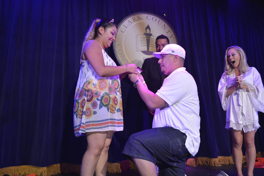 "Leo Lopez proposes to Christina Munez onstage during ""Sex Tips for Straight Women from a Gay Man"" show at Paris Las Vegas. (Courtesy: SPI Entertainment)"