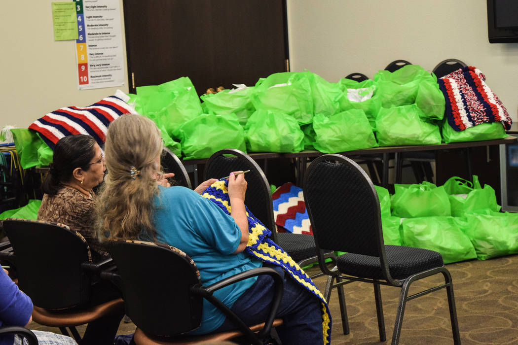 Before the celebration began, members of the Humana Charity Crafters got to work on their next donation. It typically takes anywhere from a week to a month to crochet, knit or quilt one item. (Ale ...