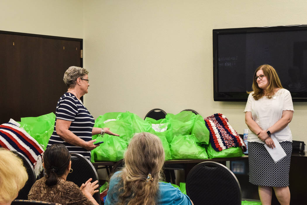 Humana's Guidance Center Coordinator was instrumental in helping form the Humana Charity Crafters in 2009. Pictured with Fisher House house manager Cadie Franco. (Alex Meyer/View) @alxmey