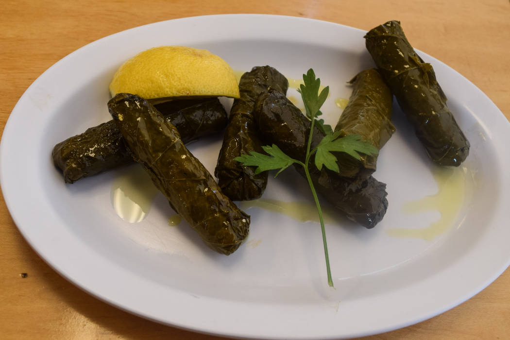 The dolmades, $5.50, are six grape leaves stuffed with rice and herbs and are served chilled with a lemon. (Alex Meyer/View) @alxmey
