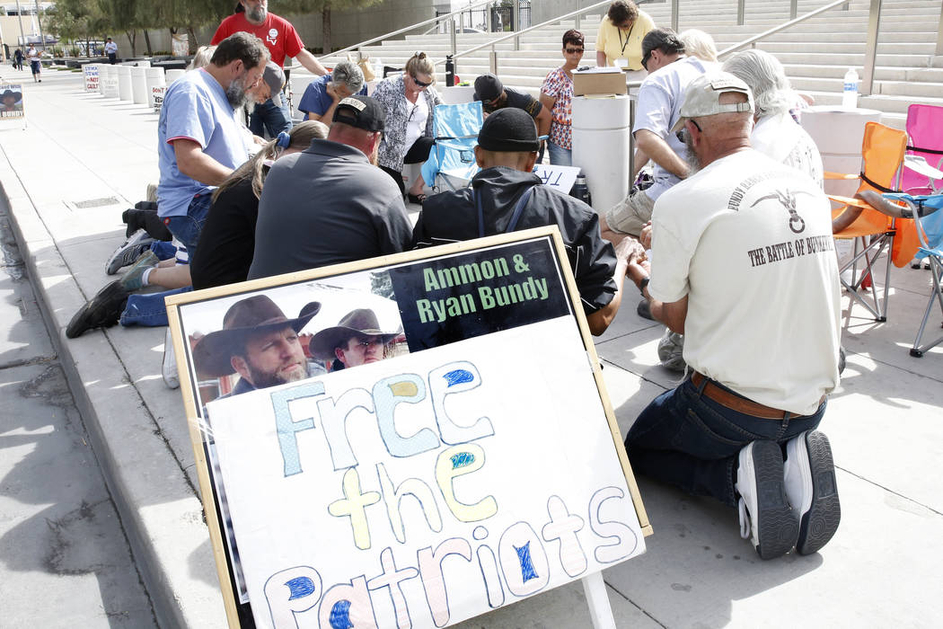 Supporters pray outside Lloyd George U.S. Courthouse as they await the jury's verdict in the first Bunkerville standoff trial on Monday, April 24, 2017, in Las Vegas. (Bizuayehu Tesfaye/Las Vegas  ...
