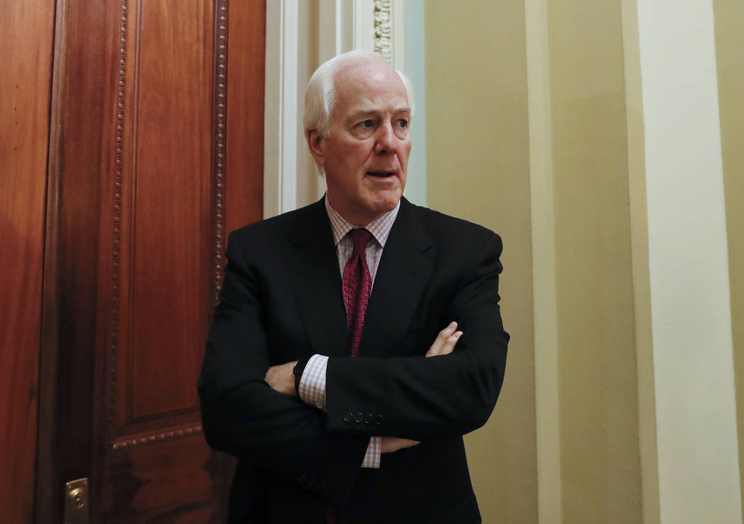 In this June 26, 2017,  file photo, Senate Majority Whip John Cornyn of Texas, pauses as he speaks to reporters outside his office on Capitol Hill in Washington.  (AP Photo/Carolyn Kaster)