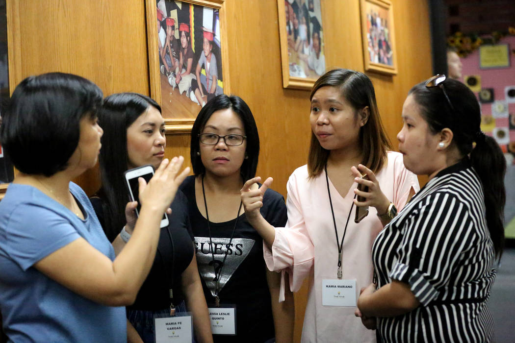 Clark County School District Director of Employee Contracts and Compensation Joyce Herreria, from left, answers questions from Maria Fe M. Vargas, Lesie Quinto, Kamia Mariano and Marielle Castro b ...