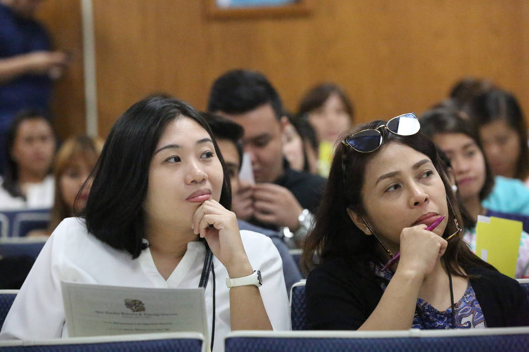 Amy Irene Salayog, left, and Gina Mejia listen during the orientation on Tuesday, July 11, 2017 of over 70 teachers that the Clark County School District brought in from the Philippines to fill a  ...