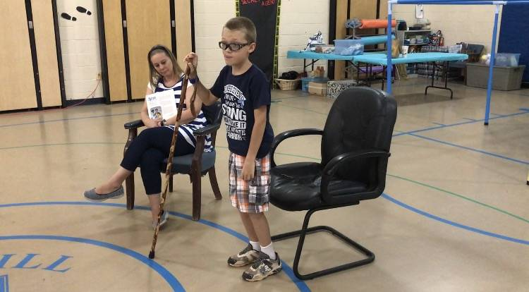 Kaspar Roden-Riisnaes explains how he can't straighten his legs because of the arthritis in his knees. He was diagnosed with juvenile idiopathic arthritis in June. (Madelyn Reese/View) @MadelynGReese