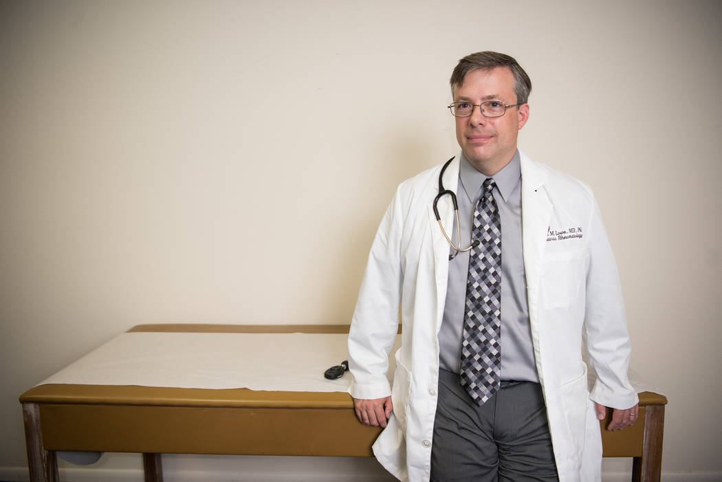 """Dr. Robert Lowe, MD, Phd in his new clinic, """"Kids Arthritis Care-Juvenile Arthritis and Rheumatology Care and Research Center"""" on Wednesday, July 12, 2017, in Las Vegas. Morgan Lieberman Las Vegas ..."""